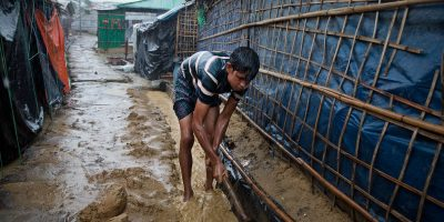 A man cleans a drainage ditch by his home during heavy rain in Chakmakul, one of the camps sheltering over 800,000 Rohingya refugees, Cox's Bazar, Bangladesh, June 13, 2018. The beginning of the monsoon season is already eroding the foundations of many shelters, and the Rohingya families' situations will only worse as the rains intensify over the next three months.